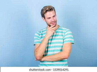 Hipster bearded face not sure in something. Thoughtful man on blue background. Hard question. Man serious face thoughtful. Have some doubts. Thoughtful expression. Need to think. Find solution.