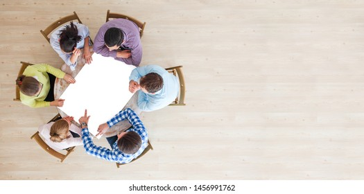 Hipster business teamwork brainstorming planning meeting concept, people team sitting around the table with white paper and pointing, copy space for content