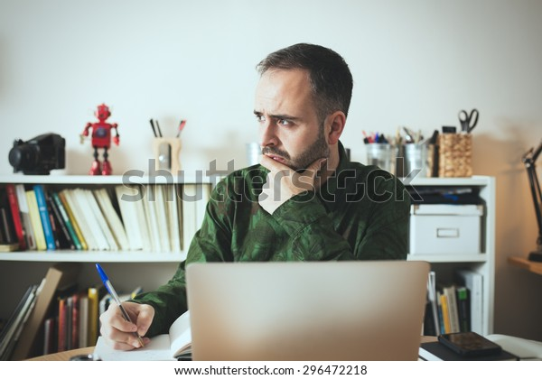 Hipster businessman thinking about new business ideas.