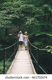 Hipster couple hiking on the background of a nature. Slovenia, Tolmin, Waterfalls of the Kozjak, Tolmin Gorges.