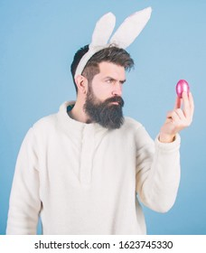 Hipster cute bunny long ears blue background. Easter bunny. Having fun. Funny bunny with beard and mustache. Join celebration. Grinning bearded man wear silly bunny ears. Easter symbol concept.