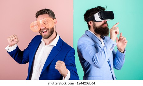 Hipster exploring virtual reality. Business implement modern technology. Real fun and virtual alternative. Man with beard in VR glasses and louvered plastic accessory. Guy interact in virtual reality.