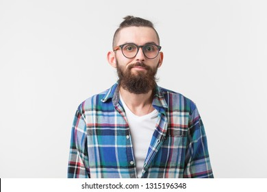 Hipster, fashion, people concept - young hipster bearded man in glasses and shirt standing over the white background