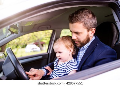 Hipster father with his little daughter in the car