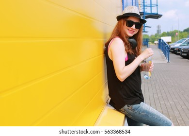 hipster girl at the blue wall