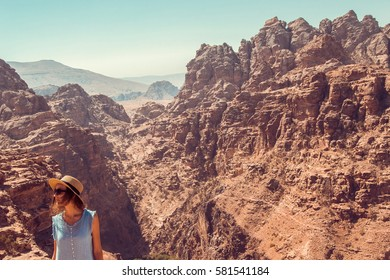 Hipster girl enjoy vacation and journey to Jordan. Gorgeous view from Petra. Negative space for text. Tourism industry. Active lifestyle. Travel concept. Middle East Woman exploring the world