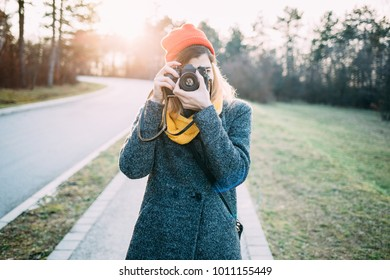 Hipster girl photographer. Young woman with retro camera