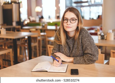 Hipster girl works in creative office or cafe