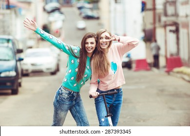 Hipster girlfriends posing and fun in fashion color clothes