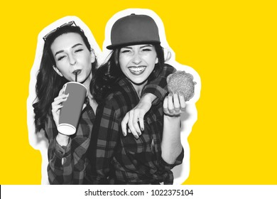 Hipster girls with vegetarian burger drinking a cocktail from straw and having fun, happy, smile and laugh on the white background.
