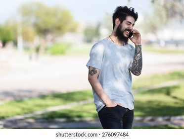 hipster guy with tattooed arm using a laptop.focus on keyboard