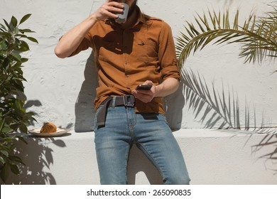hipster guy using his smart phone outdoors