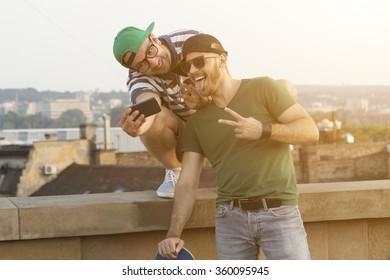 Hipster guys enjoy outdoors.