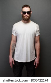 Hipster handsome male model with beard wearing white blank t-shirt with space for your logo