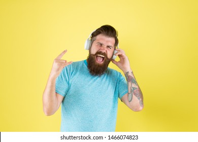 Hipster happy using modern wireless headphones. Freedom going wireless offers you is unparalleled. Modern technology. Bearded man listen music wireless gadget. Wireless headphones deliver clean sound.
