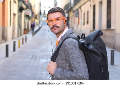 Hipster looking businessman listing to music