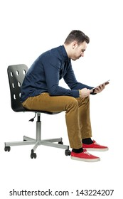 Hipster man in bow tie looking stylish using tablet white sitting on chair