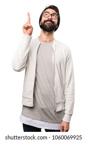 Hipster man pointing up on white background