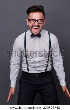f38f88134463 Hipster man screaming and shouting because of happiness. Handsome man in  white shirt and bow tie standing with his eyes closed. - Image