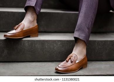 Hipster man wear fashion shoes tassel loafer.On old  floor. Stylish men shoes concept.