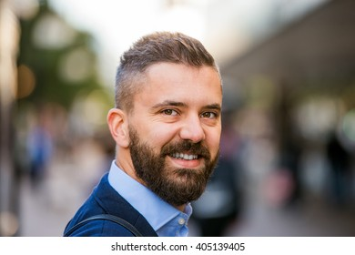 Hipster manager in blue shirt walking in the street