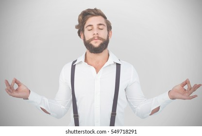 Hipster meditating arms outstretched against white background with vignette