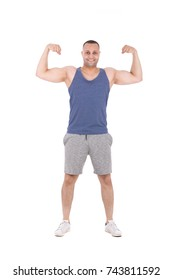 Hipster muscular athlete pumping his biceps. Isolated on white background.