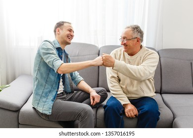 Hipster son with his senior father at home