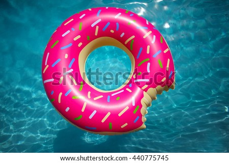 pool water with float pool party hipster sprinkled donut float in sunny pool background straight down on bright clear water sprinkled donut float sunny pool stock photo edit now