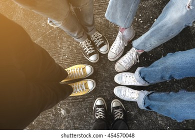 Hipster standing with sneakers in circle on concrete ground .top view