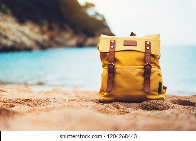 Hipster swimming mask on background sea ocean horizon, hiker tourist yellow backpack on sand beach, blurred panoramic seascape blank, traveler relax holiday concept, sunlight view in trip vacation