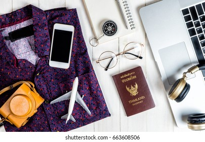 Hipster travel blogger writer accessories flatlay on white wood