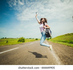 Hipster Traveler with backpack . happy jumping