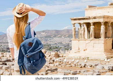 Hipster Traveler with backpack and outspread hands. Enjoying sun in the Acropolis