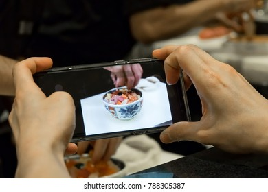 Hipster using smart phone to take photo for japanese food cooking, hipster lifestyle concept.