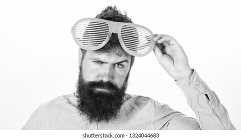 Hipster wear shutter shades extremely big sunglasses. Man bearded guy wear giant louvered sunglasses. Eye protection sunglasses accessory concept. Sunglasses party attribute and stylish accessory.