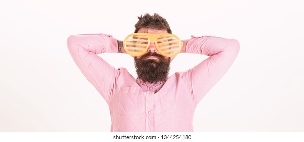Hipster wear shutter shades extremely big sunglasses. Man bearded guy wear giant louvered sunglasses. Sunglasses party attribute and stylish accessory. Eye protection sunglasses accessory concept.