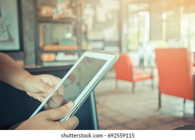 Hipster woman holds tablet sync app, Using Online banking payment by network internet wireless development mobile smartphone for Businessshopping in coffee shop, Internet concept.