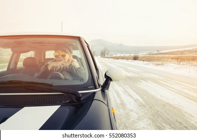 Hipster woman sitting in a small car