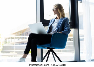 Hipster Woman use Laptop huge Loft Studio.Student Researching Process Work.Young Business Team Working Creative Startup modern Office.Analyze market stock,new strategy