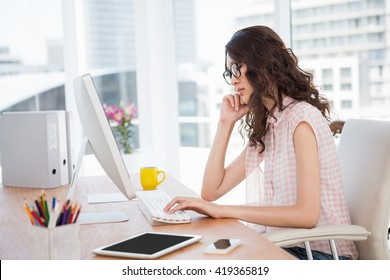 Hipster woman using a computer at work