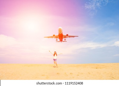 Hipster young girl with airplane landing to airport