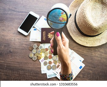 Hipster young woman and Magnifying glass which planning of her vacation trip and searching information with smartphone ,wanderlust Travel concept.