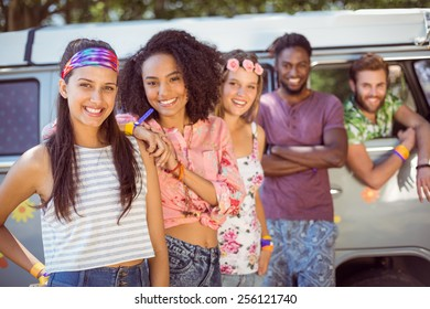 Hipsters hanging out by camper van at a music festival