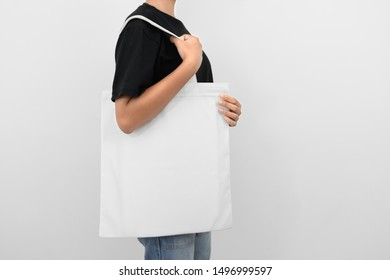 hipter woman holding eco fabric bag isolate on white background