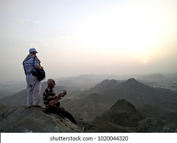 Hira Cave, Saudi Arabia - 29th August 2017, Two old man friend enjoy at on top of Hira Cave during sunrise.