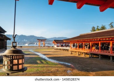 Hira-butai, the open-air stage at Itsukushima Shrine is located in front of the Main Shrine in the middle ground with the famous Torii Gate blurred in the background -Miyajima Island, Hiroshima, Japan