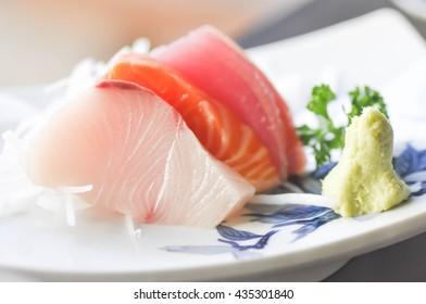 hirame sashimi,salmon sashimi and tuna sashimi dish