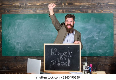 Hiring teachers for new school year. Back to school teachers recruitment. Man bearded holds blackboard inscription back to school. Looking committed teacher complement qualified workforce educators.