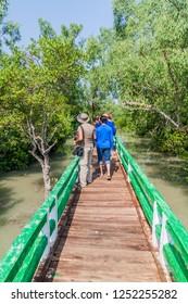 HIRON POINT, BANGLADESH - NOVEMBER 14, 2016: Tourists on a boardwalk at Hiron Point in Sundarbans, Bangladesh.